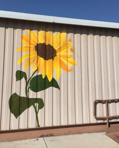 ALMA painted sunflower at LADE charter school